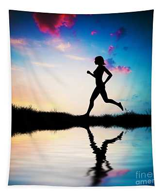 Silhouette Of Woman Running At Sunset Tapestry