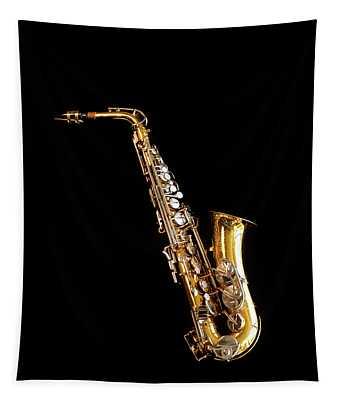 Single Saxophone Against Black Tapestry