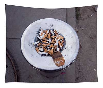 A Lot Of Cigarettes Stubbed Out At A Garbage Bin Tapestry
