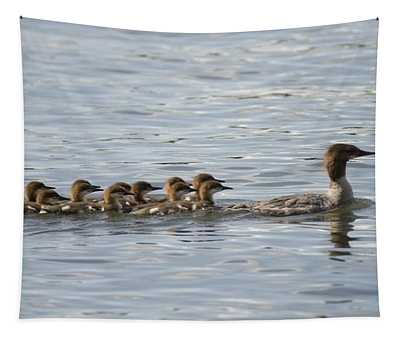 Duck And Ducklings Swimming In A Row Tapestry