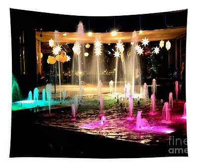 Water Fountain With Stars And Blue Green With Pink Lights Tapestry