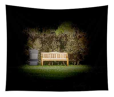 A Trash Can And Wooden Benches In A Small Grassy Area Tapestry