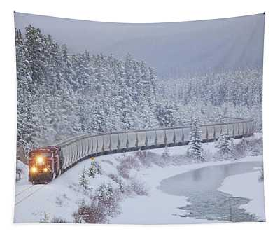 A Canadian Pacific Train Travels Along Tapestry