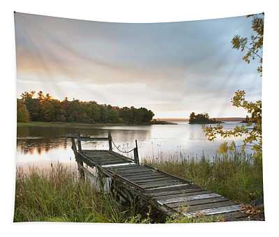A Dock On A Lake At Sunrise Near Wawa Tapestry