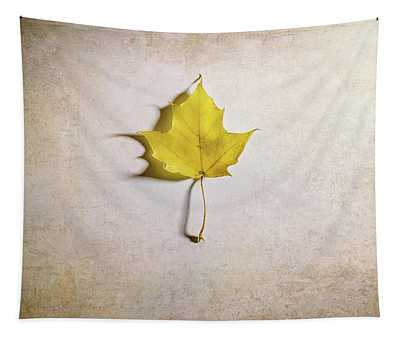 A Single Yellow Maple Leaf Tapestry