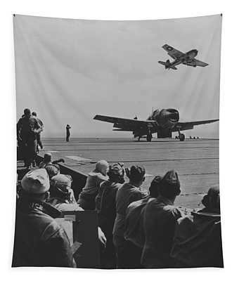 A Us Navy Hellcat Fighter Aircraft Landing On The Deck Of A Carrier Tapestry