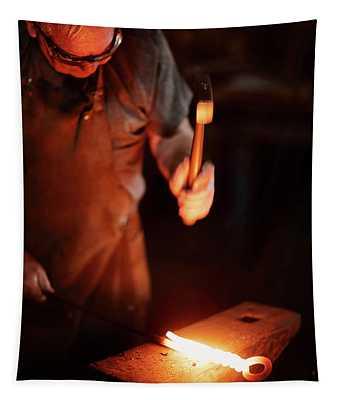 Close-up Of  Blacksmith Forging Hot Iron Tapestry