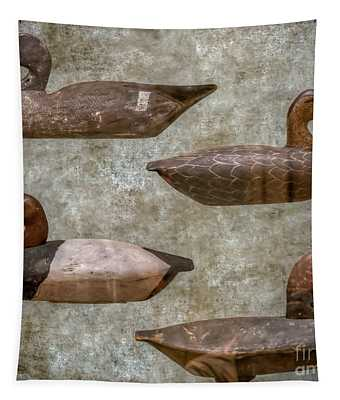 Duck Decoys On Brown Tapestry