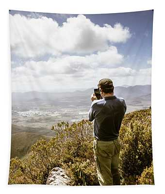 Male Tourist Taking Photo On Mountain Top Tapestry