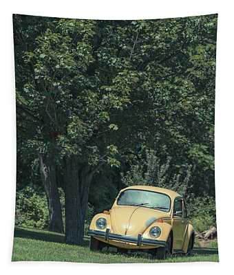 Old Yellow Vw Bug Under A Tree Tapestry
