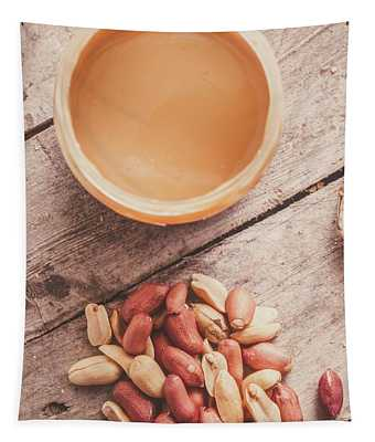 Peanut Butter Jar With Peanuts On Wooden Surface Tapestry