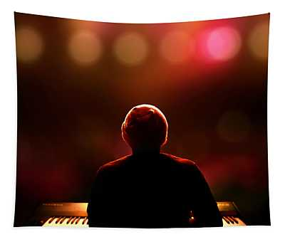 Pianist On Stage From Behind Tapestry