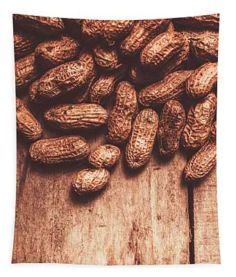 Pile Of Peanuts Covering Top Half Of Board Tapestry