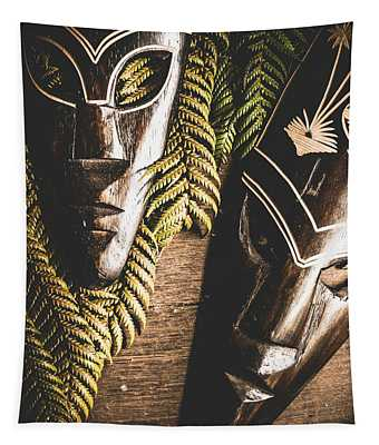 Tribal Masks With Ferns On Wooden Table Tapestry