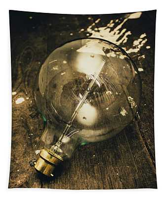 Vintage Light Bulb On Wooden Table Tapestry