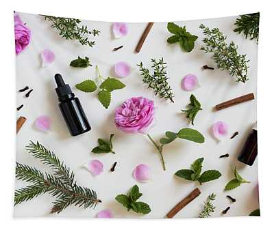 Selection Of Essential Oils And Herbs On A White Background Tapestry