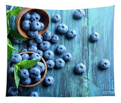 Bowl Of Fresh Blueberries On Blue Rustic Wooden Table From Above Tapestry