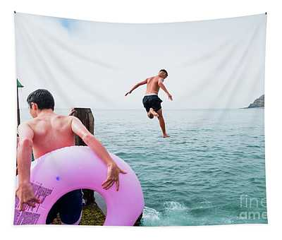 Boys Jumping Into The Sea Tapestry