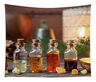 Christmas Collection Of Essential Oils With Frankincense, Wintergreen And Candles Tapestry