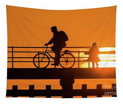 Cyclist Silhouetted At Sunset Tapestry