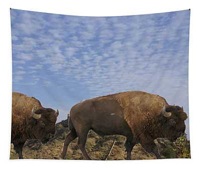 Group Of Bison Walking Against Rocky Mountains  Tapestry