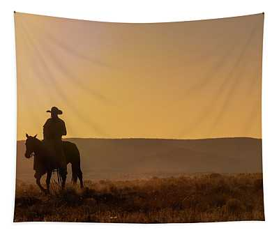 Lone Desert Cowboy Riding At Sunrise Tapestry