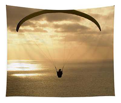 Paraglider Flying In The Sky Over An Tapestry