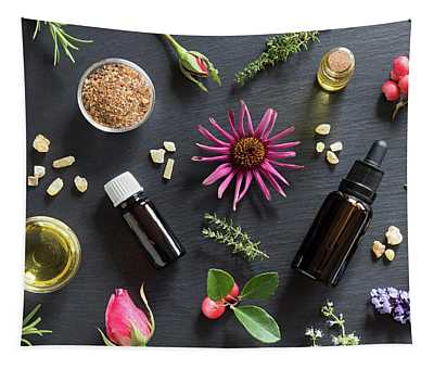 Selection Of Essential Oils And Herbs On A Dark Background Tapestry