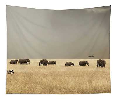 Stormy Skies Over The Masai Mara With Elephants And Zebras Tapestry