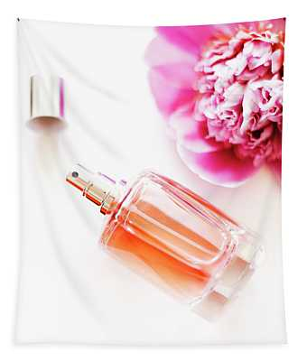 Top View Of Luxury Perfume Bottle And Pink Peony Flower On White Tapestry