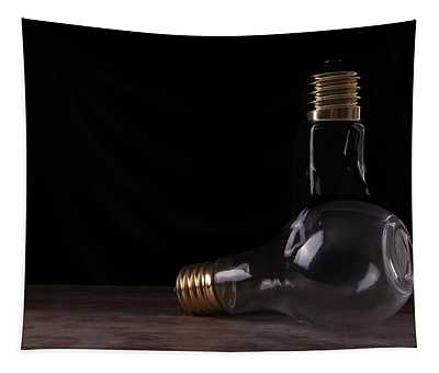 Two Light Bulbs Arranged On A Wooden Table  Tapestry