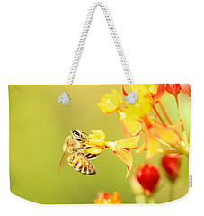 Bee On Milkweed Weekender Tote Bag by Greg Allore