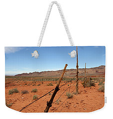 Weekender Tote Bag featuring the photograph  Don't Fence Me In by Tammy Espino