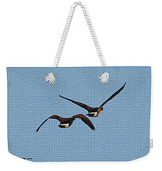 Weekender Tote Bag featuring the photograph  Fleeing Geese by Tom Janca