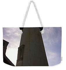 Weekender Tote Bag featuring the photograph  Light House Sky by Susan Garren