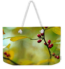 Weekender Tote Bag featuring the photograph  Spicebush With Red Berries by Rebecca Sherman