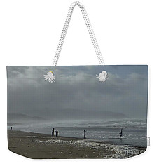 Weekender Tote Bag featuring the photograph  Wave Handstand  by Susan Garren