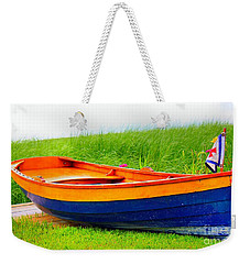 Weekender Tote Bag featuring the photograph  Wood Row Boat by Judy Palkimas