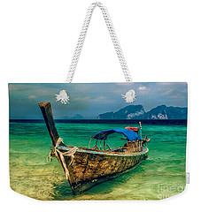 Weekender Tote Bag featuring the photograph Asian Longboat by Adrian Evans