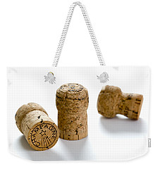 Weekender Tote Bag featuring the photograph Champagne Corks by Lee Avison