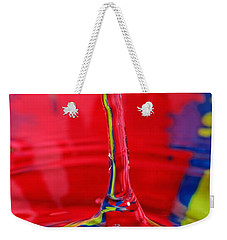 Weekender Tote Bag featuring the photograph Colorful Water Drop by Peter Lakomy