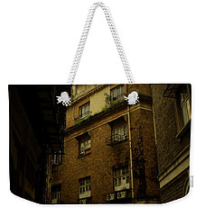 Weekender Tote Bag featuring the photograph Crime Alley by Salman Ravish