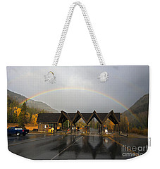 East Gate Of Yellowstone And Rainbow Weekender Tote Bag