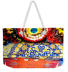 Weekender Tote Bag featuring the photograph Eye On Fabrics by Michael Hoard
