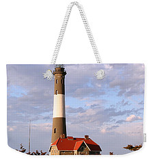 Weekender Tote Bag featuring the photograph Fire Island Lighthouse by Karen Silvestri