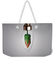 Weekender Tote Bag featuring the photograph Flower In Bulb by Bess Hamiti