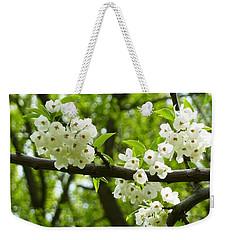 Weekender Tote Bag featuring the photograph Flowers In The Spring by Mike Ste Marie
