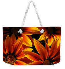 Weekender Tote Bag featuring the photograph Gazania Named Kiss Orange Flame by J McCombie