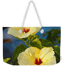 Weekender Tote Bag featuring the photograph Bright Yellow Hibiscus by Roselynne Broussard