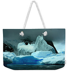Weekender Tote Bag featuring the photograph Iceberg by Amanda Stadther